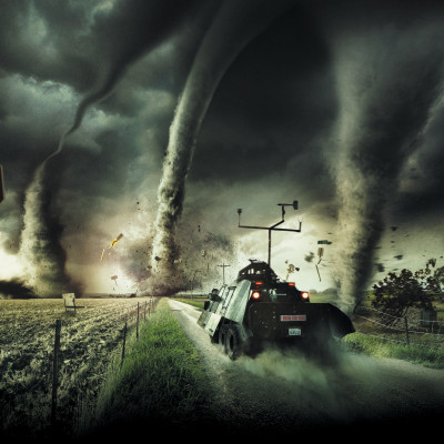 A storm vehicle tears through a road full of tornadoes.
