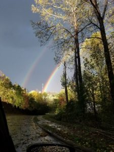 A double rainbow streaks across the sky after the storm.