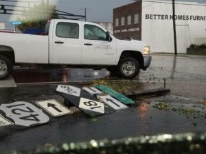 Street signs blown over in the road.