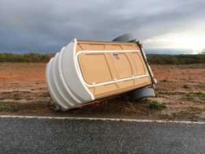 Port-a-john tipped over on a trailer.